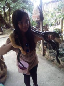 Our guest trying to smile with the pythons